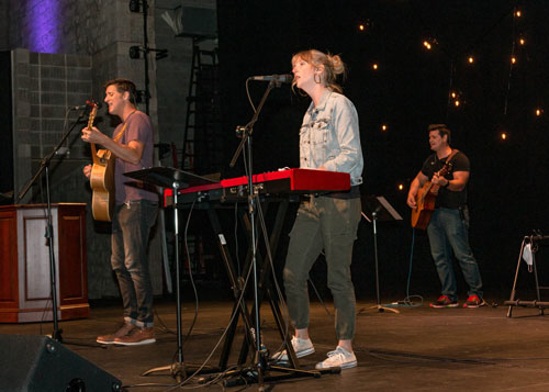 Jeremy and Kim Scowden lead praise and worship at Homecoming Chapel.