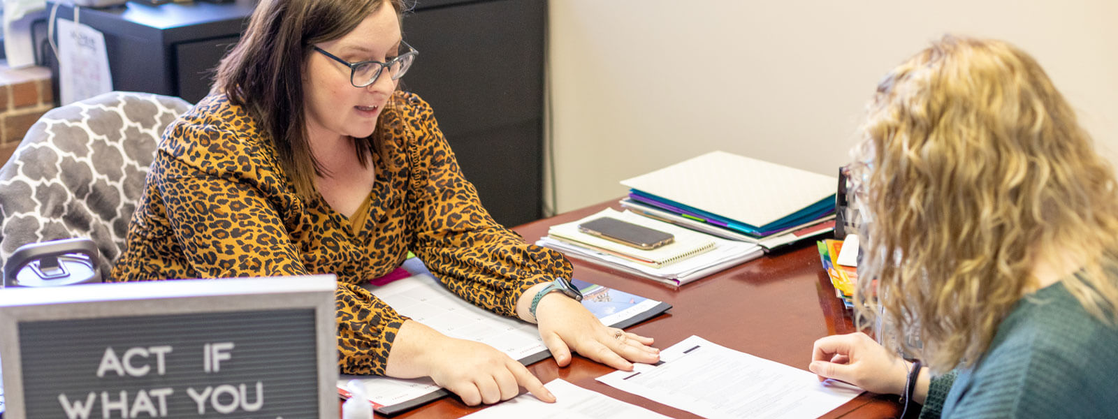 student interacts with professional at career fair