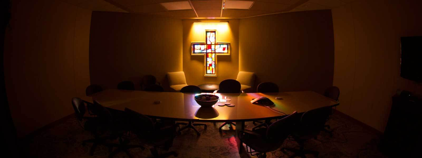 stained glass cross window in conference room