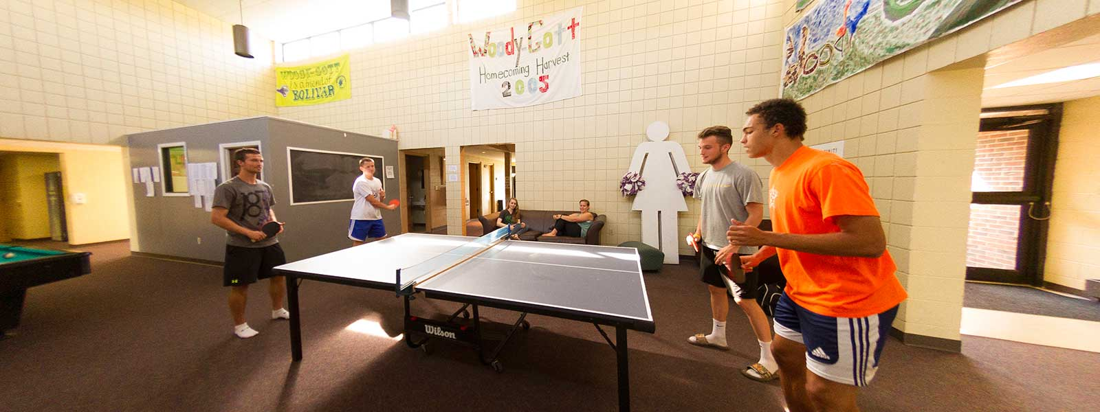 students playing ping-pong in dorm lobby