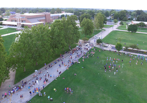 Aerial view of students hanging out on forum on SBU campus