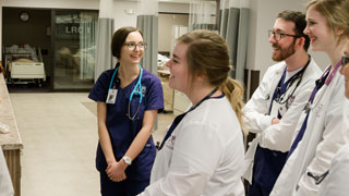 students talk and smile in nursing training center