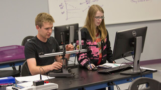 two students working on physics project