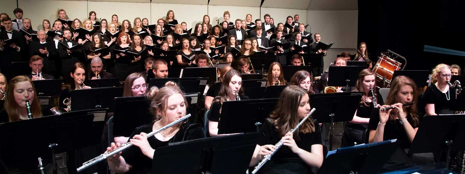 Choral and instrumental ensembles perform together