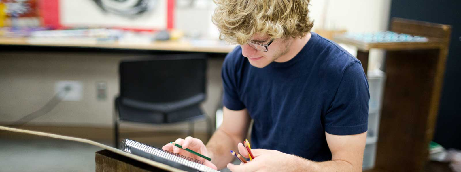 art student works on drawing project