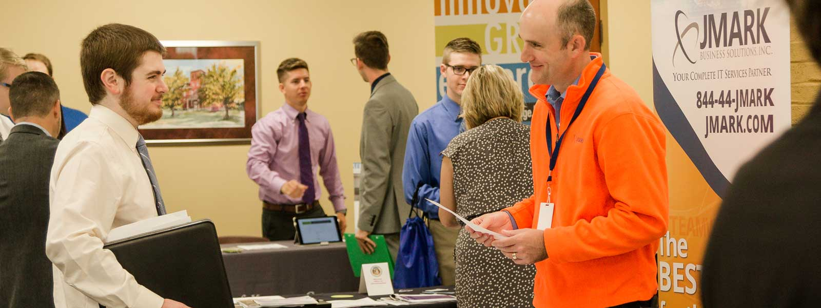 students interact with professionals at career fair