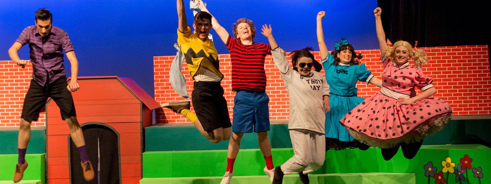 "students performing in theatre production of ""You're a Good Man, Charlie Brown"""