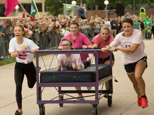 SBU students participating in bed races