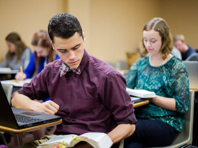 student reading book in class