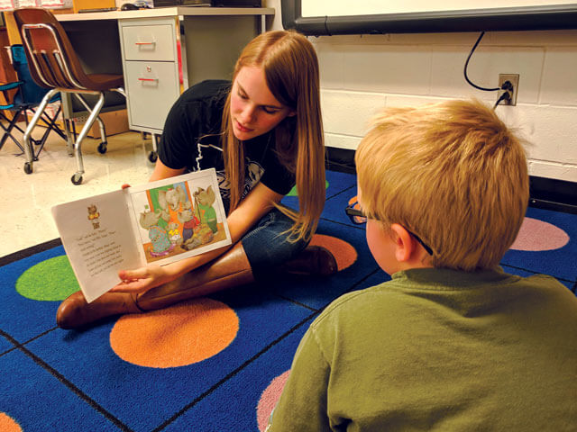 SBU student reads to child